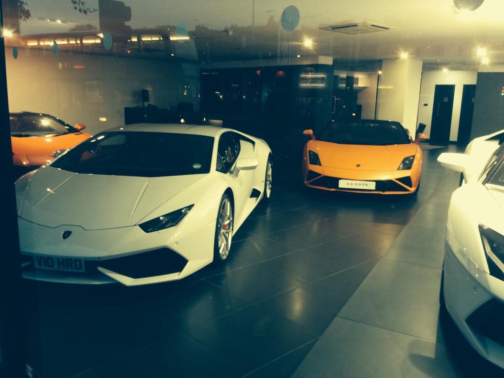 The White Huracán nestled between Gallardos and an Aventador at the H.R. Owen Lamborghini delaership in South Kensington