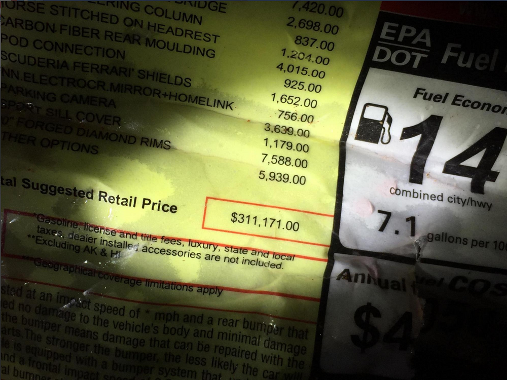 Documentation inside the car showing the value of the Ferrari